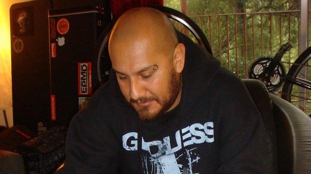 Marco Santiago plays a quijada in his home. (Radio Bilingue)