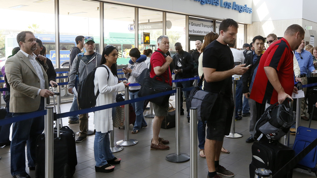 Travelers stand in line at Los Angeles International Airport on Monday. Congress moved quickly this week to give the Federal Aviation Administration flexibility to end air traffic controller furloughs that resulted in flight delays at several airports. (AP)