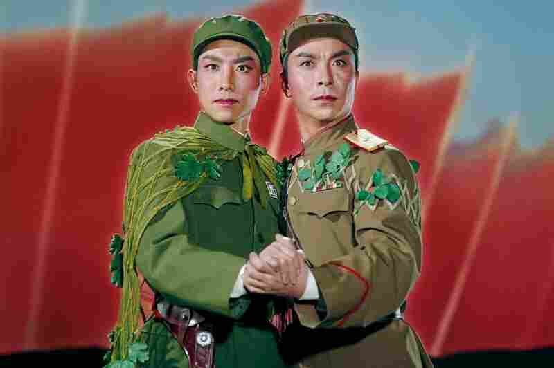 "Photographer Zhang Yaxin created incredible and indelible images as stills from the array of ""model"" operas and ballets planned and sanctioned by the Chinese government during the Cultural Revolution.A Chinese and North Korean solider embrace in Raid on the White Tiger Regiment, 1971."