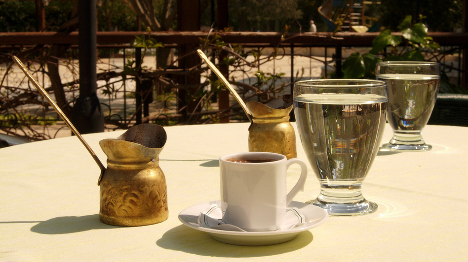 Throughout the region that was once the Ottoman empire, people make coffee pretty much the same way: using coffee beans ground into a fine powder, then boiled in a little brass pot that the Turks call a <em>cezve</em>. (maxpax/via Flickr)