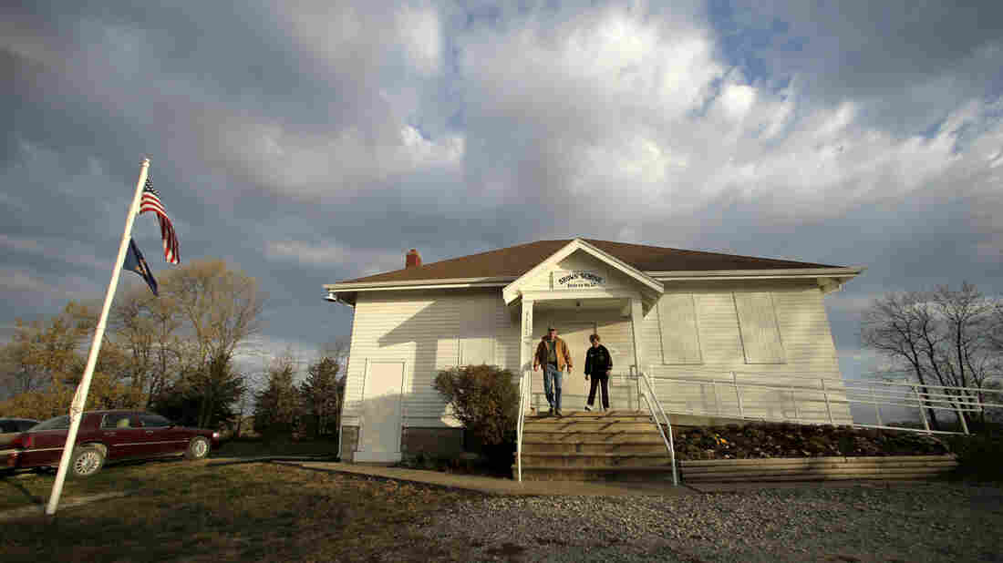 Karl and Twilla Eisele, of Wellsville, Kan., leave the old Brown School after voting on Nov. 6, 2012, in rural Wellsville, Kan. Recent elections have made the Kansas Legislature the most conservative in the state's history.