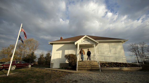 Karl and Twilla Eisele, of Wellsville, Kan., leave the old Brown School after voting on Nov. 6, 2012, in rural Wellsville, Kan.