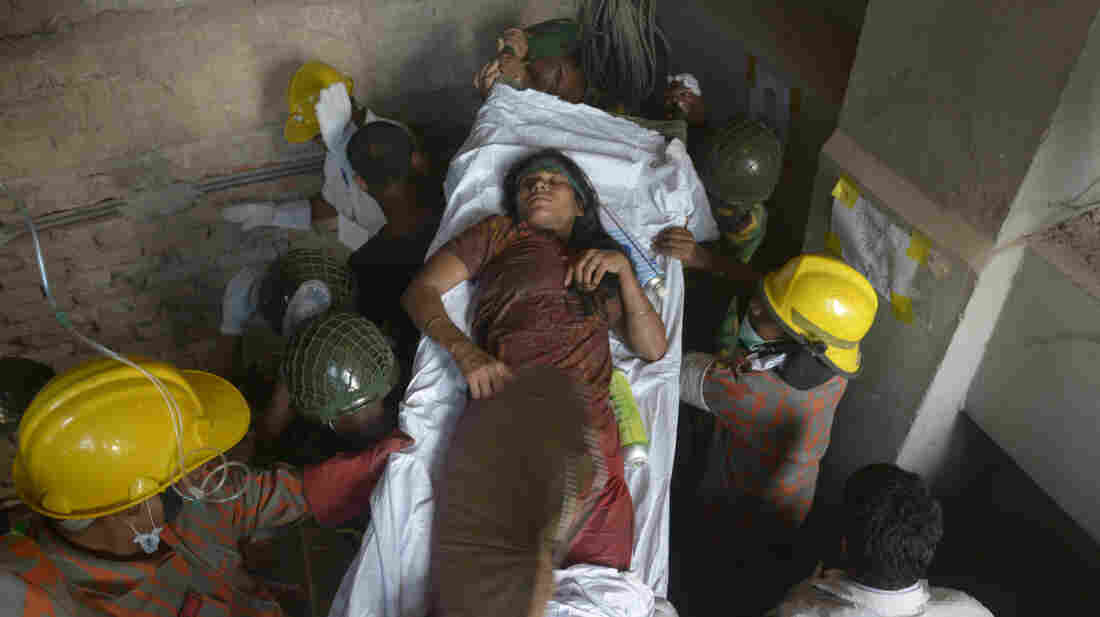 Rescue workers evacuate a survivor found in the garment factory building that collapsed Wednesday in Savar, near Dhaka, Bangladesh, on Sat., April 27, 2013.