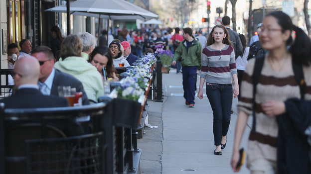 People walk and eat along Boylston Street, near the site of the Boston Marathon bombings, on Wednesday. Businesses in the area have reported strong customer support; they also have an option for federal loans to help them cope with losses. (Getty Images)