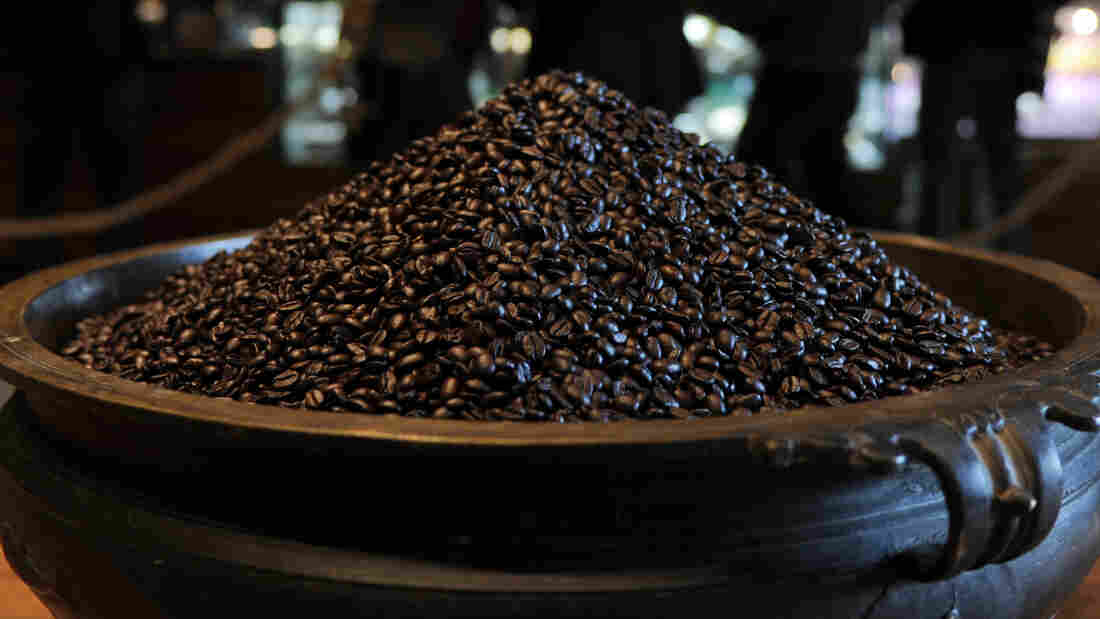 A Lot Of Beans: A charity auction of a cup of coffee with Apple CEO Tim Cook has garnered bids topping $600,000. In this file photo, a pot of beans sits in a Starbucks store.