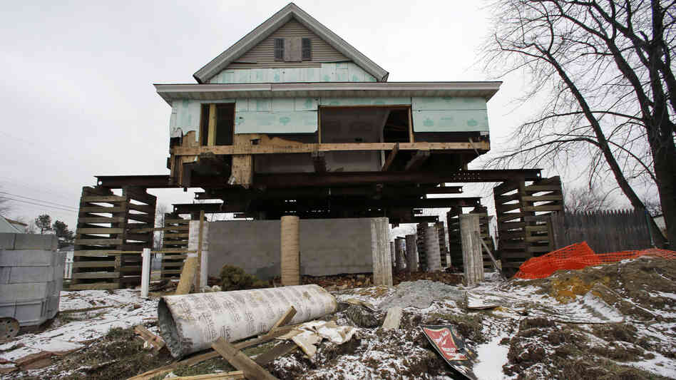 A home damaged by Superstorm Sandy in Union Beach, N.J., sits on a raised platform to protect it from future