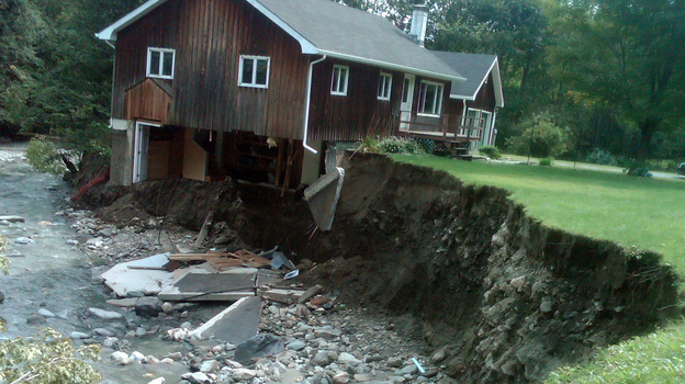 A house destroyed by Tropical Storm Irene sits in Rochester, Vt., in 2011. (AP)