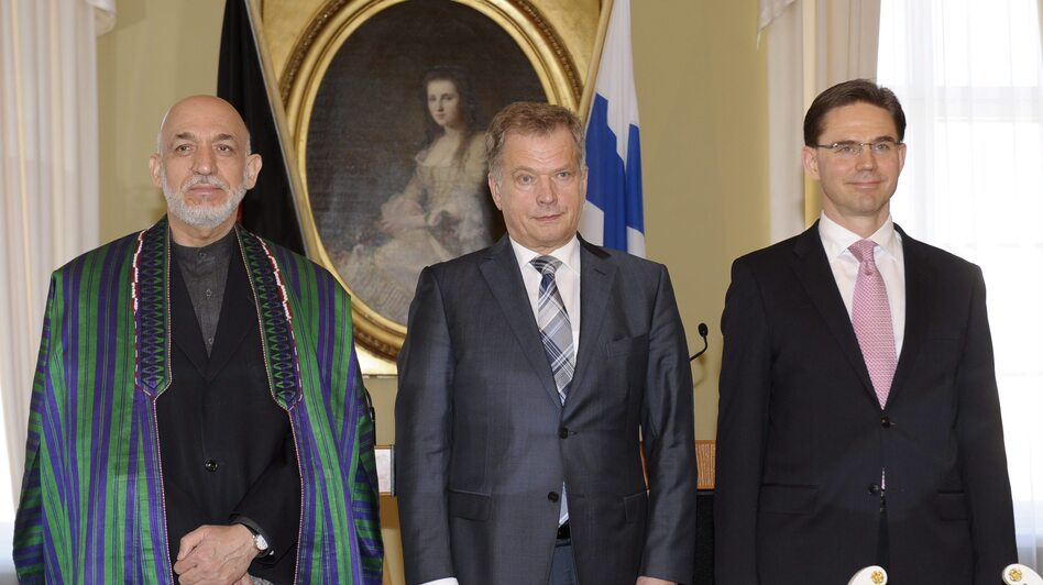 Afghan President Hamid Karzai with Finnish President Sauli Niinisto (center) and Finnish Prime Minister Jyrki Katainen on Monday. (AFP/Getty Images)
