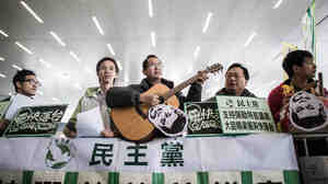 Pro-democracy supporters in Hong Kong sing and shout slogans during a January protest. Chinese leaders and the state-run media are now speaking often of the Chinese dream, though there's no real consensus on what it means.