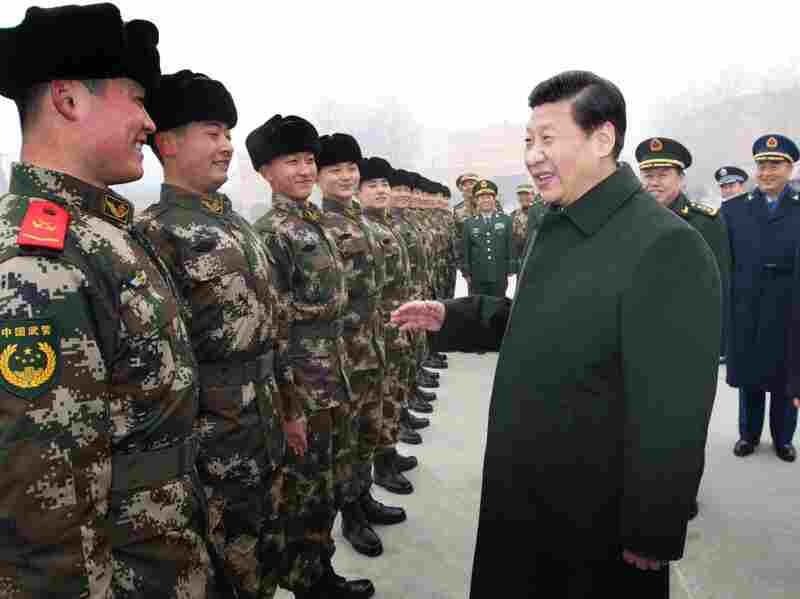 Chinese Preisdent Xi Jinping (center) talks with members of the Chinese People's Armed Police Force in Beijing on Jan. 29.