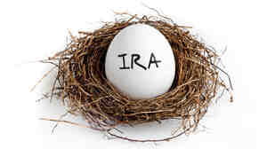 A white egg in a nest on a white background with the word IRA on the egg.
