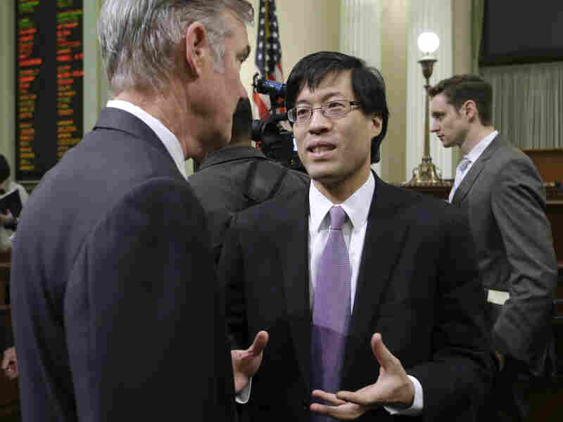 Californian State Assemblyman Richard Pan (center) is the author of legislation that would bar higher prices for health insurance sold to smokers.