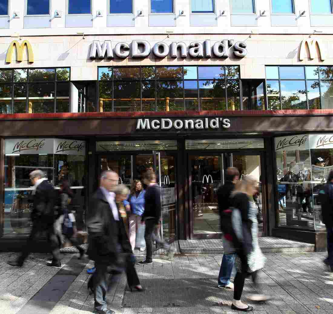 Fast times on the Champs-Elysees: People walk past a McDonald's on one of Paris' most storied avenues. But it's not just McD's that has caught French interest: Fast food now accounts for the majority of restaurant spending in the country.