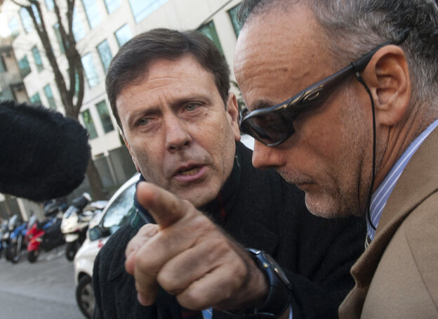 Doctor Eufemiano Fuentes, left,  arrives at a court house in Madrid on January 28, 2013.