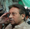 Former Pakistani President Pervez Musharraf is escorted from a courtroom on April 20.