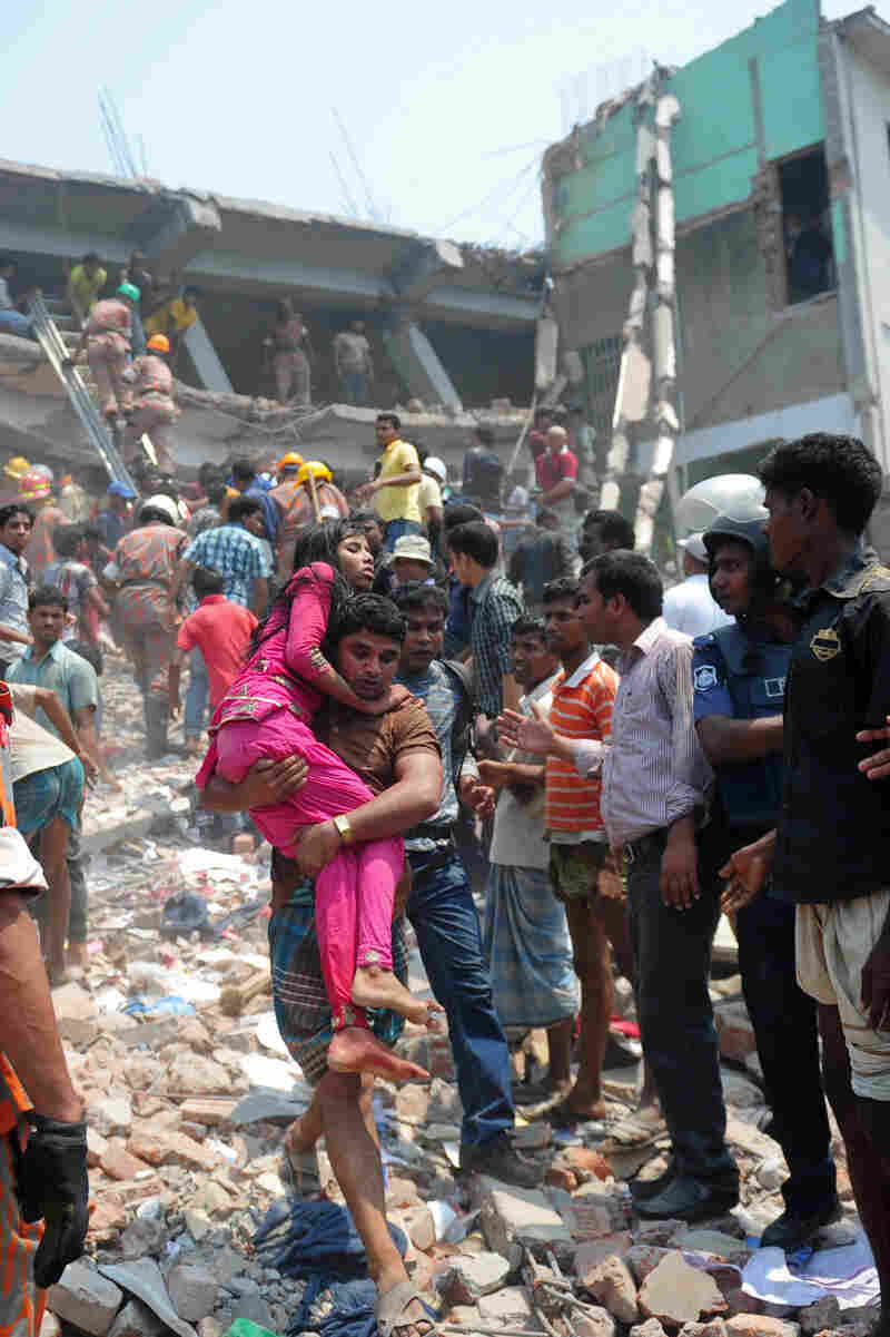 A  volunteer carries an injured garment worker after a building collapsed in Savar, on the outskirts of Dhaka, Bangladesh, on April 24, killing hundreds of people.