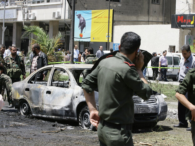 Syrian government security officers after a blast in the Marjeh district of Damascus on T