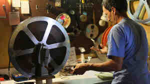 After Tuesday, projectionist Andy Holyoke will help retire the Little Art Theatre's vintage Italian reel-t