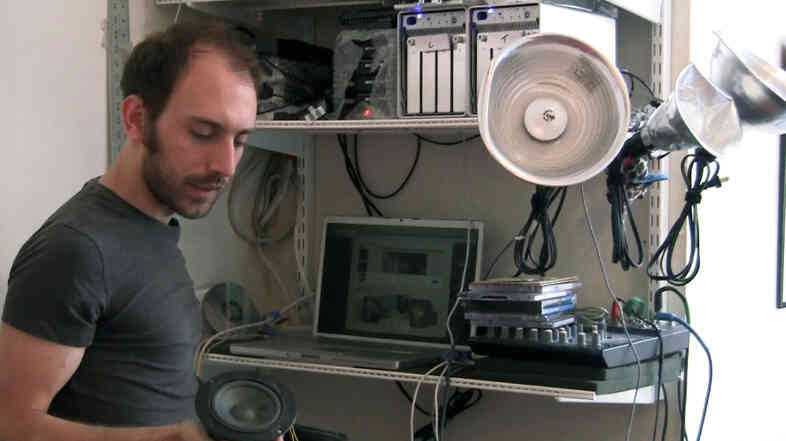 Composer Tristan Perich in his home and workspace.