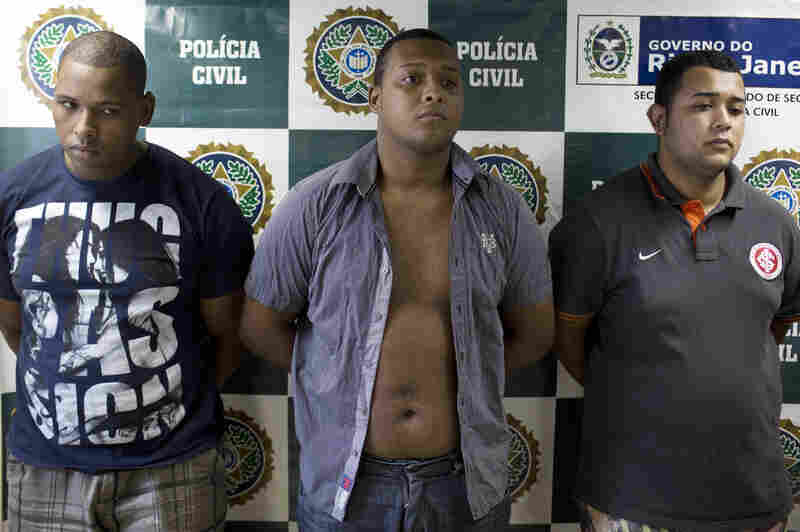 Wallace Aparecido Souza Silva (from left), Carlos Armando Costa dos Santos and Jonathan Foudakis de Souza were arrested this month for allegedly gang-raping an American tourist and beating her male companion in Rio de Janeiro. An alleged accomplice, arrested later, was reported to be 14 years old.