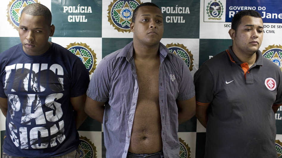 Wallace Aparecido Souza Silva (from left), Carlos Armando Costa dos Santos and Jonathan Foudakis de Souza were arrested this month for allegedly gang-raping an American tourist and beating her male companion in Rio de Janeiro. An alleged accomplice, arrested later, was reported to be 14 years old. (AP)