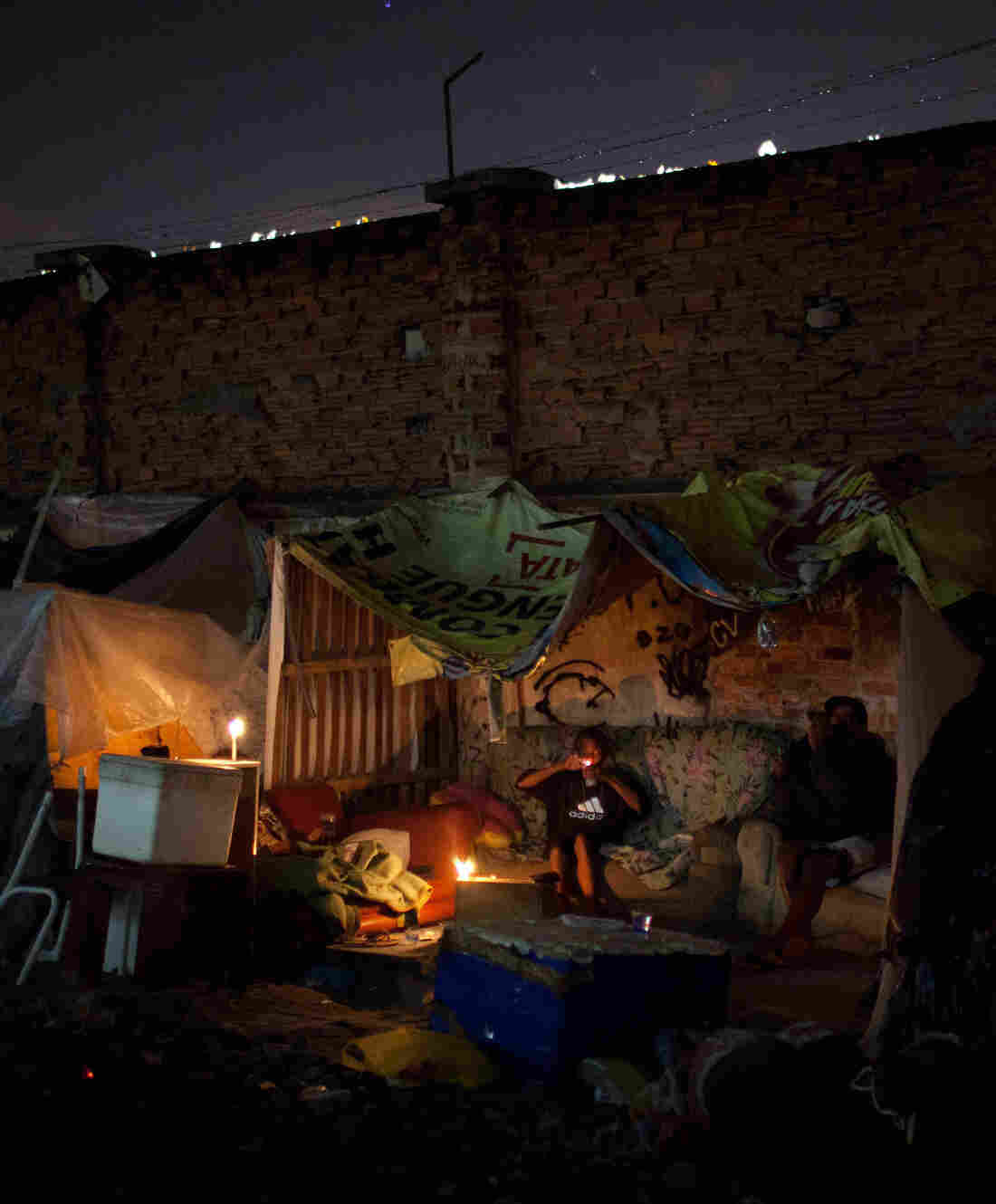 A youth smokes crack in the Manguinhos slum in Rio de Janeiro in 2012. A crack epidemic is one factor contributing to the sharp rise in crime committed by Brazilian minors.