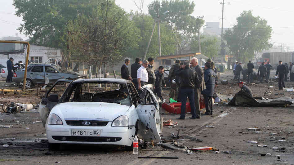 Investigators work at the site of a bombing in the Dagestan capital, Makhachkala, last year. The blasts near a police post killed at least 15 people. The southern Ru