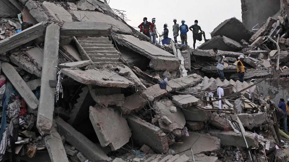 Bangladeshi rescue workers take a break Friday on the rubble of a building that collapsed Wednesday in Savar, near Dhaka, Bangladesh. By Friday, the death toll reached 300 as rescuers continued to search for injured and missing. (AP )