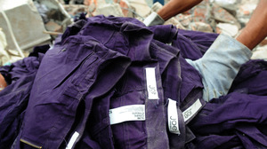 An item of clothing with a Joe Fresh label lies in the rubble after a multistory building collapsed in Savar, Bangladesh.