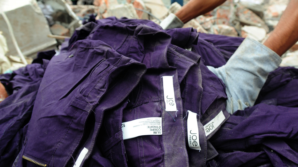 An item of clothing with a Joe Fresh label lies in the rubble after a multistory building collapsed in Savar, Bangladesh. (AFP/Getty Images)