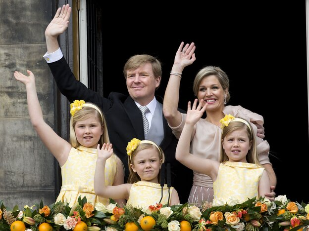 New Dutch King Willem-Alexander, Queen Maxima and their daughters wave to the crowd Tuesday from the balcony of the royal palace in Amsterdam.