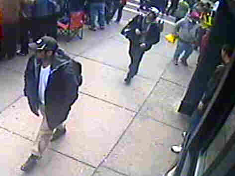 This image from a surveillance video helped investigators identify Tamerlan Tsarnaev (in black cap) and his brother, Dzhokhar (in white cap), as the main suspects in the Boston Marathon bombings.