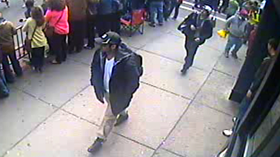 This image from a surveillance video helped investigators identify Tamerlan Tsarnaev (in black cap) and his brother, Dzhokhar (in white cap), as the main suspects in the Boston Marathon bombings. (FBI.gov)