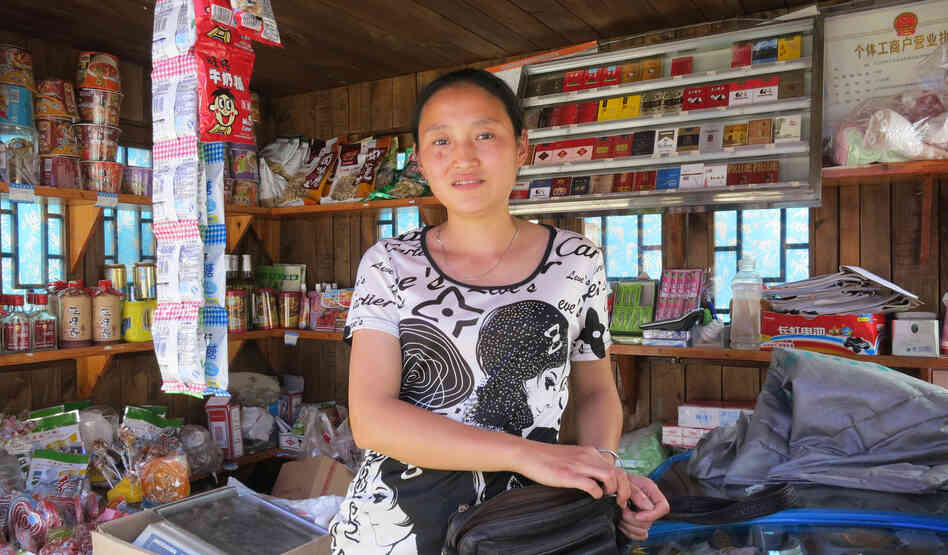 "Zhang Ming lost her 5-year-old daughter, her parents and her home in the 2008 Sichuan earthquake. She now operates a stall selling food and drinks, and she and her husband have another daughter. But life is difficult. ""We are facing the problem of how to survive, so we don't have time to think of anything else. If you have too much free time, you think about things too much."""