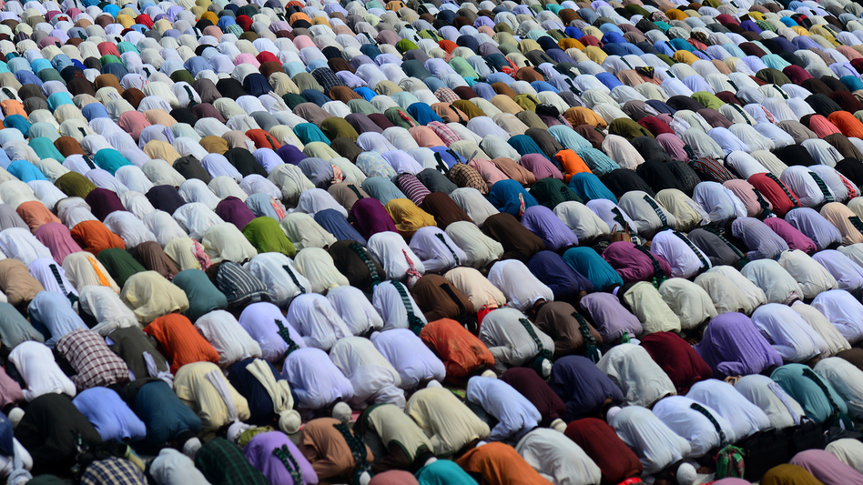 Faithful in Bangladesh offer Friday prayers during a street protest in the capital, Dhaka, in March. (AFP/Getty Images)