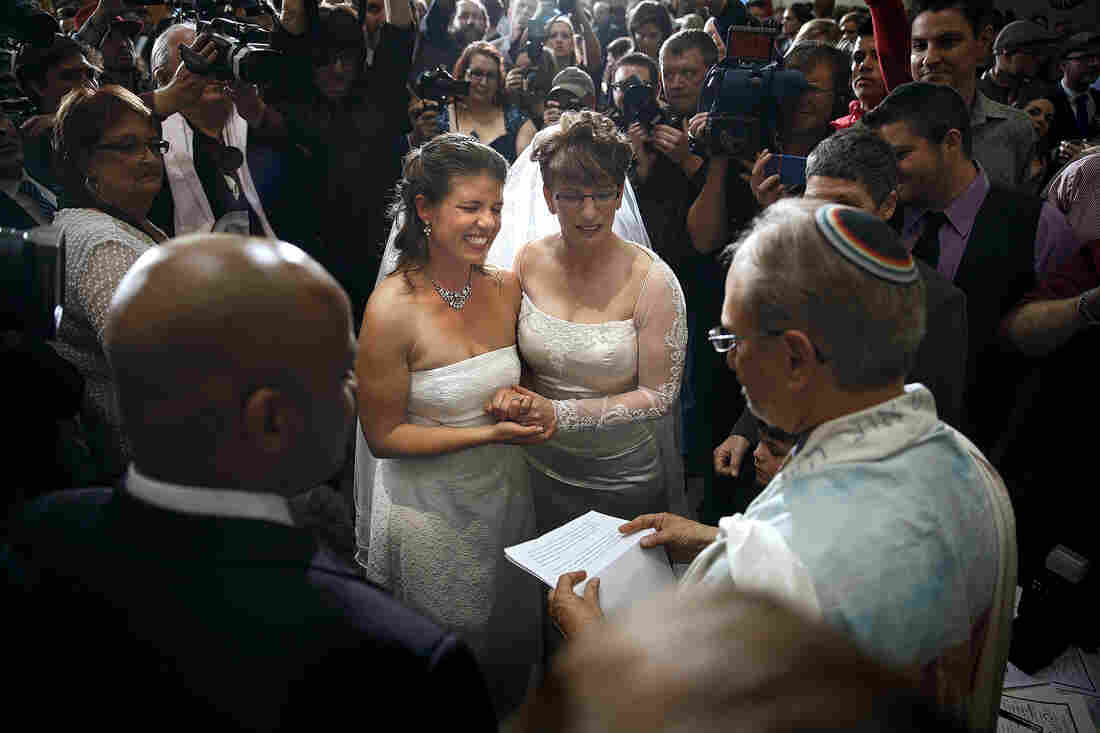 Anna, left, and Fran Simon, both of Denver, Colo., are the first same-sex couple to be issued a Civil Union license at a midnight ceremony in the Denver Office of the Clerk and Recorder, at the Wellington E. Webb Municipal Office Building on Wednesday.
