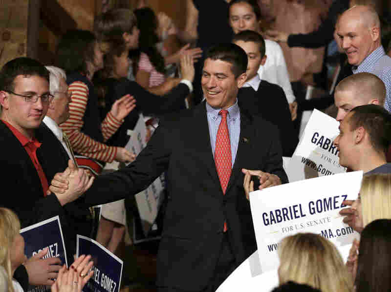 Republican Senate hopeful Gabriel Gomez celebrates with supporters as he makes his way to the stage to deliver a victory speech Tuesday in Cohasset, Mass.