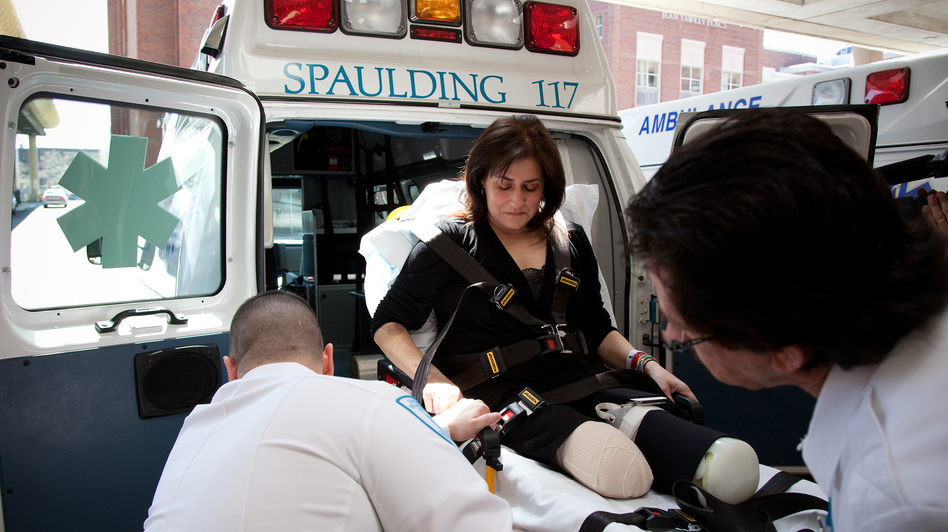 Celeste Corcoran is transported to Spaulding Rehabilitation Hospital on April 28. (Ellen Webber for NPR)
