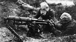 Soldiers with the British Machine Gun Corps wear gas masks in 1916 during World War I's first Battle of the Somme.