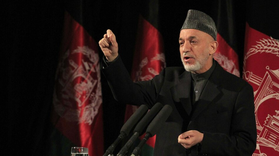 Afghan President Hamid Karzai acknowledged a report this week that the CIA has regularly been sending him money. Afghans seem to have mixed feelings. The president is shown here speaking at an event in Kabul on March 10. (S. SABAWOON/EPA/Landov)