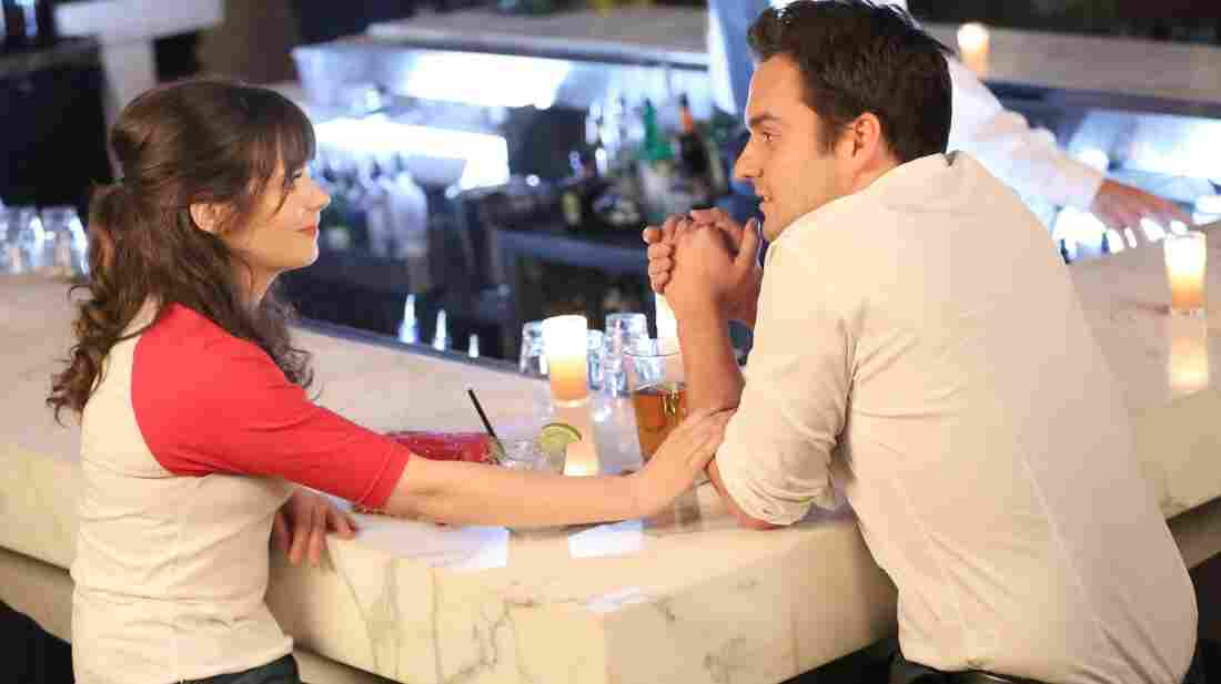 Jess (Zooey Deschanel) and Nick (Jake Johnson) have one of their many chats on Fox's New Girl.