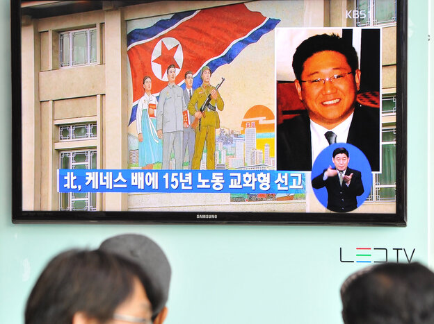 Passersby watch a local television broadcast in Seoul on Thursday showing a report on the sentencing of Kenneth Bae.