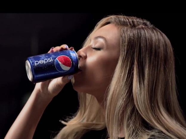 """Beyonce in her most recent Pepsi ad, which premiered her song """"Grown Woman."""""""