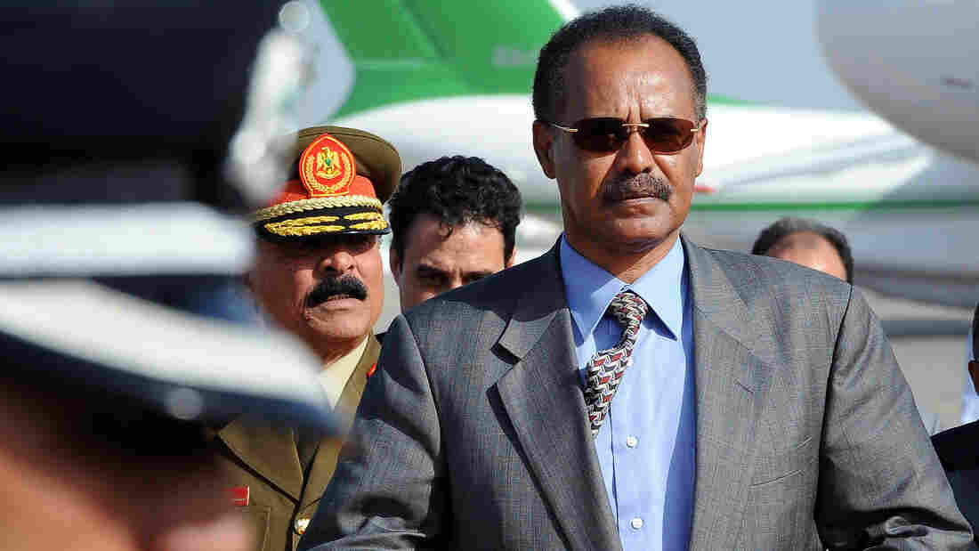 Eritrea's President Isaias Afwerki, shown on a visit to Libya in 2010, has been widely criticized by human rights groups. Eritrean exiles have organized passive protests, calling on people to stay home Friday.