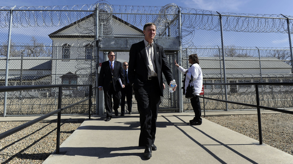 Colorado Governor John Hickenlooper, center, exits the Fort Lyon Correctional Facility in Las Animas, Colo., on Wednesday after touring the facility. Hickenlooper has proposed closing the facility due to budget concerns.