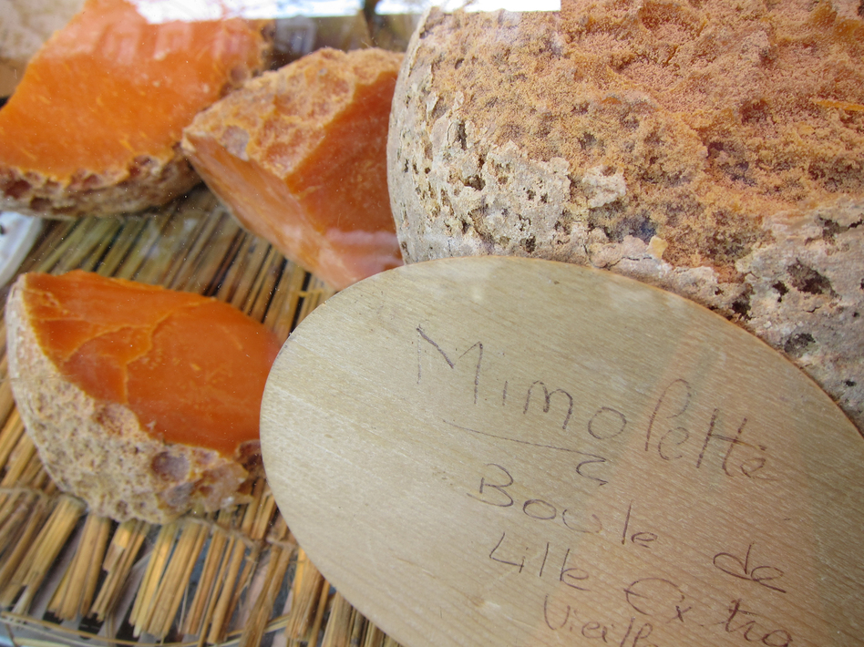 Microscopic bugs called cheese mites are responsible for giving Mimolette its distinctive rind and flavor. (Chris Waits/via Flickr)