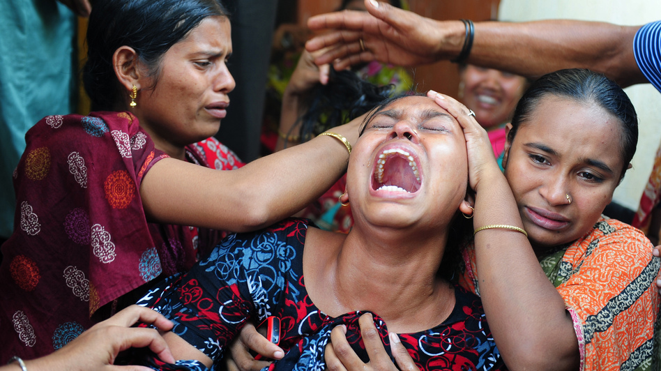 Relatives react after identifying the body of a loved one who was killed in last week's building collapse in Savar, on the outskirts of Dhaka, Bangladesh. (AFP/Getty Images)