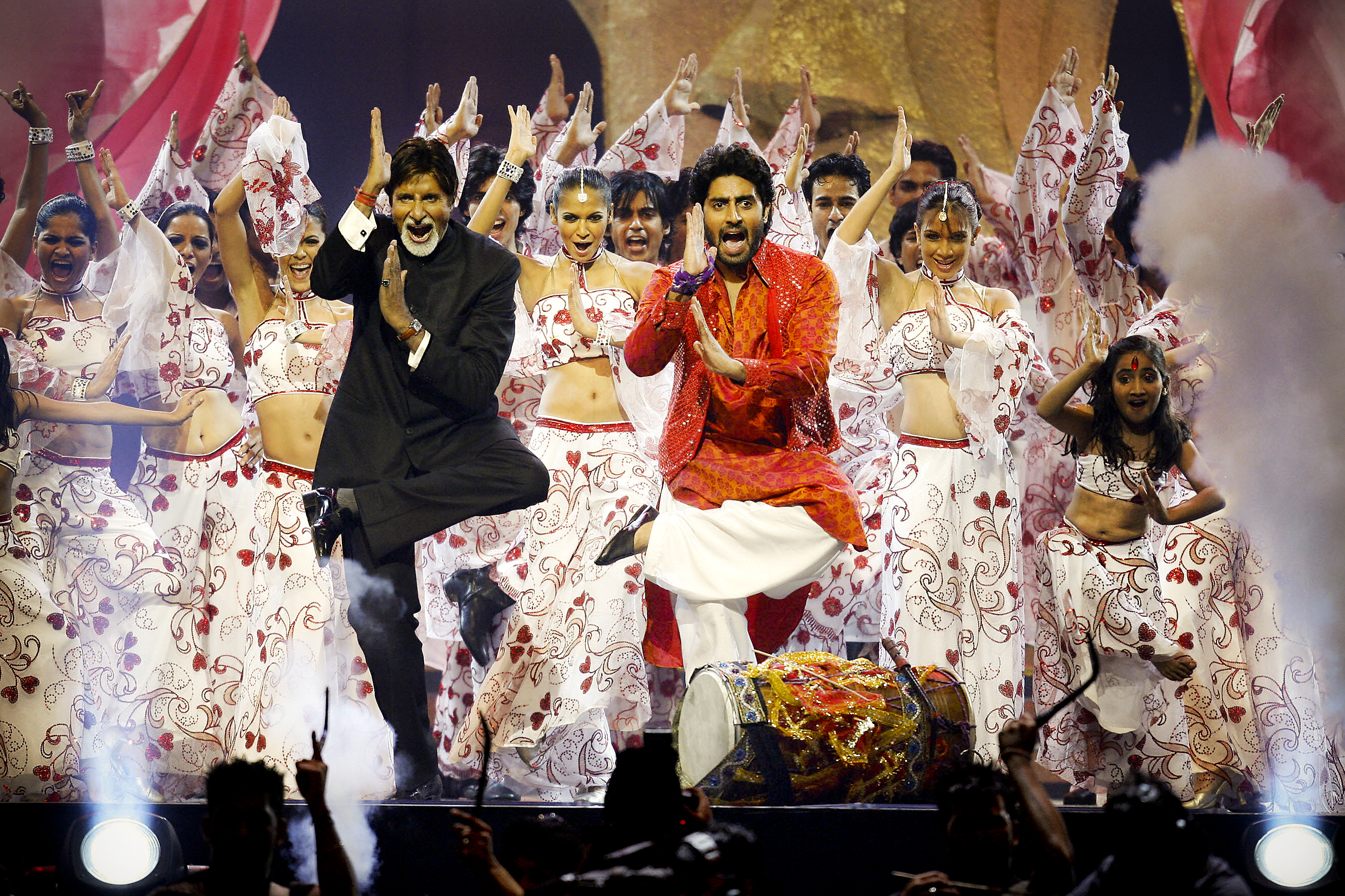 Indian film legend Amitabh Bachchan and his son, Abhishek Bachchan, perform during the International Indian Film Academy Awards ceremony in England, in 2007. The awards, known as the Bollywood Oscars, are watched by hundreds of millions of people around the world.