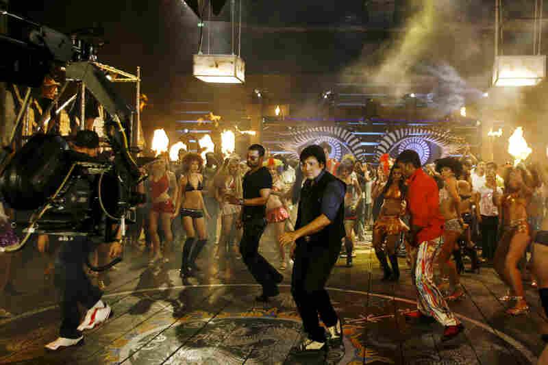 Bollywood actors Sunil Shetty (from center left), Govinda and Javed Jaffrey film the movie Loot in Mumbai, in 2008.