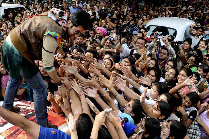 Actor Ranbir Kapoor (left) is greeted by enthusiastic young students during a film promotional tour at a women's college in Amritsar, India, in 2011.